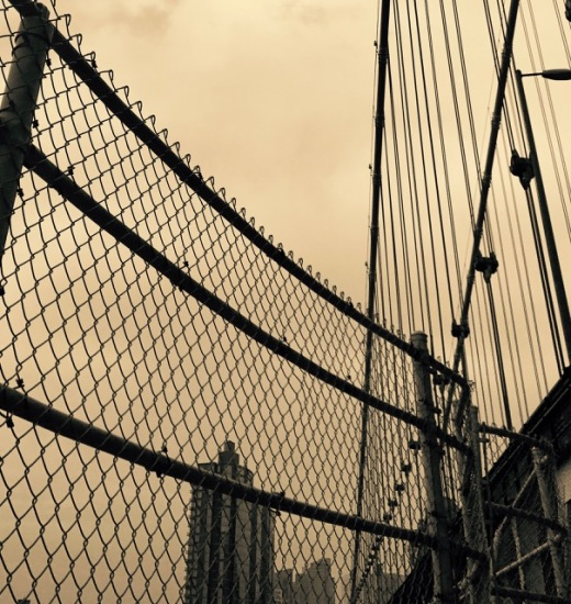 The Manhattan Bridge and a discolored sky