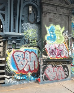 This is a picture of some colorful graffiti on the Manhattan Bridge